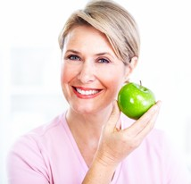 smiling senior woman with apple