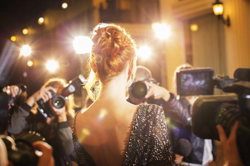 Celebrity showing her dental implants in Jonesboro to paparazzi